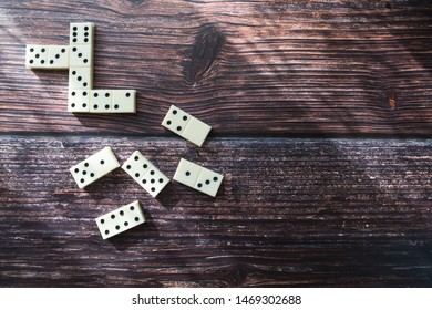 Domino game, dominoes on the wooden table background