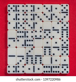 the domino game pieces on a red colored surface
