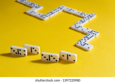 the domino game pieces on a yellow colored surface