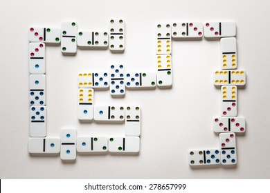 domino laid out in a game shot in the studio on white paper background