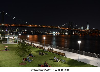Domino Park In Williamsburg, Brooklyn at Night With Williamsburg Bridge and Manhattan Skyline In the Background