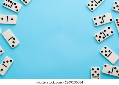 Domino pieces on blue background