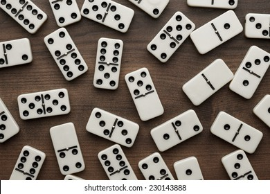 domino pieces on the brown wooden table background