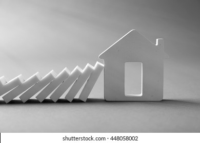 Dominoes with house shape on grey background