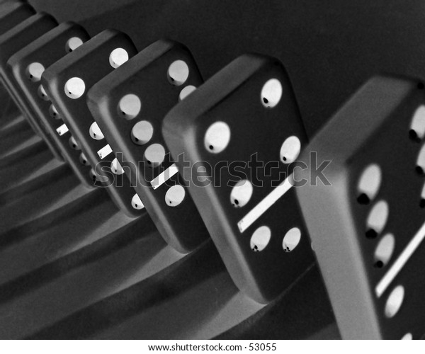 Dominoes lined up ready to tumble. Nice clean desktop background.