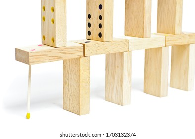Dominoes and match building isolated on the white background. Weak support concept