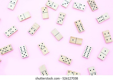 Dominoes on top view,Pink background.Flat lay