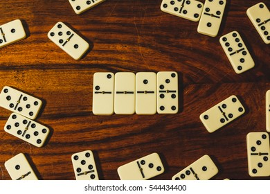 Dominoes on wooden background reading 2017 centered from top