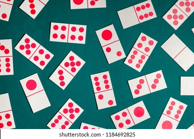 Dominoes playing card on green color table