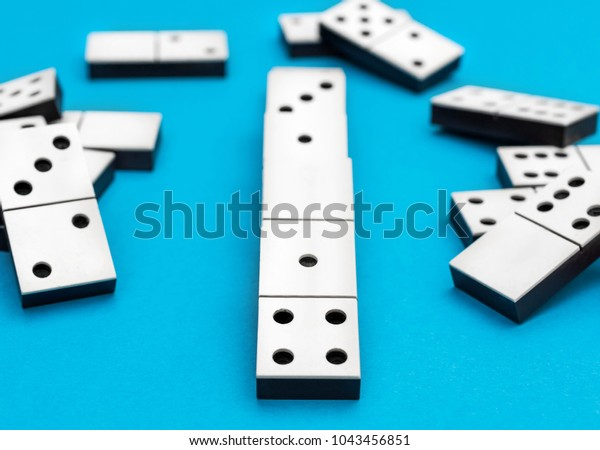 Dominos Pieces On Blue Background Stock Photo (Edit Now