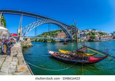 Dom-Luis bridge at Porto in nPortugal. Barcos rabelos.