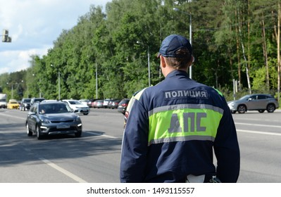 DOMODEDOVO, MOSCOW REGION, RUSSIA - JUNE 1, 2019:Inspector of road patrol police on the road