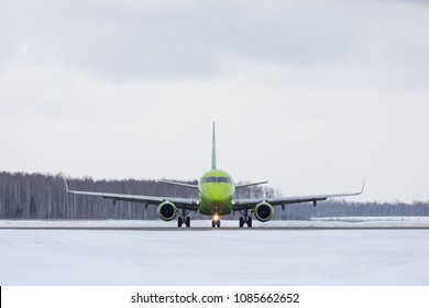 DOMODEDOVO, MOSCOW REGION, RUSSIA - MARCH 27, 2018: S7 Airlines Embraer 170-100SU (Registration VQ-BYR). Plane makes taxiing on taxiway in Domodedovo International Airport.