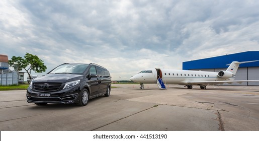 DOMODEDOVO, MOSCOW, RUSSIA - JUNE 03, 2016: Private busines Jet airplane with Mercedes Benz V-class luxury car with tuning kit of Larte Design Tuning Company shown together at international airport