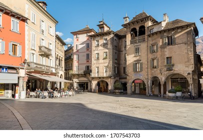 Domodossola, Piedmont, Italy - November 11, 2016: View of the Market square or Piazza del Mercato with medieval buildings and street cafes in the historic center of Domodossola, Italy