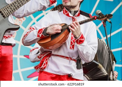 Domra player in traditional Russian clothes