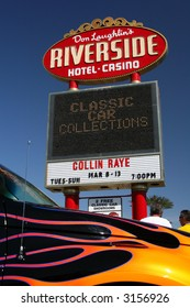 At Don Laughlin's Riverside Hotel and Casino in Laughlin, Nevada, is a marquee advertising a classic car collection museum there. In the foreground is a PT Cruiser.