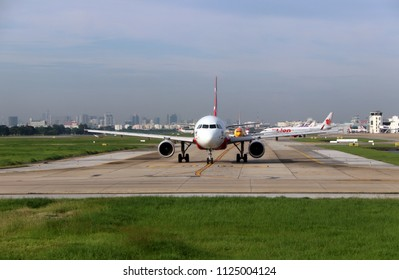 Don muang, Bangkok, Thailand, June 6, 2018 : Airbus A320 neo of of Thai Airasia, Boeing 737-8AS, of Nokair, plane of Thai Lion Air and other airlines run in a row on the runway to prepare for flight.