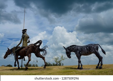 Don Quixote with lance and shield on horseback with pony in Varadero, Cuba - April 8, 2014