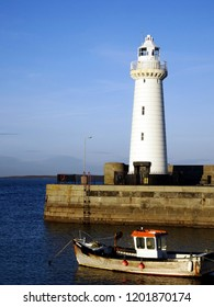 Donaghadee Lighthouse in sunset light, Landmark in Northern ireland