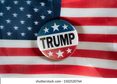 Donald Trump campaign button against United States of America flag.