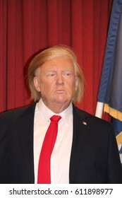 Donald Trump, London, United Kingdom - March 20, 2017: Donald Trump American President wax figure waxwork portrait in oval office White house set,  at museum, London