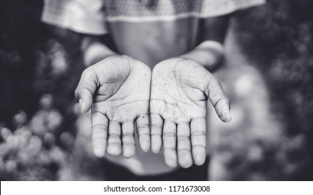 Donate and Charity concept.Two beggar hands palms up from Rohingya Muslims boy in Rohingya camp.Poor children Concept.black and white tone.