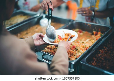 donate food to the homeless : The hands of the poor handed a plate to receive food from volunteers to alleviate hunger