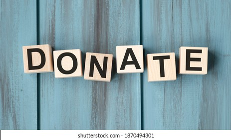 Donate text on a wooden blue background