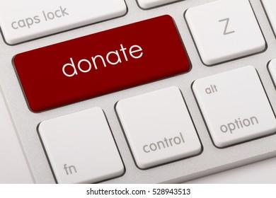 Donate word written on computer keyboard.