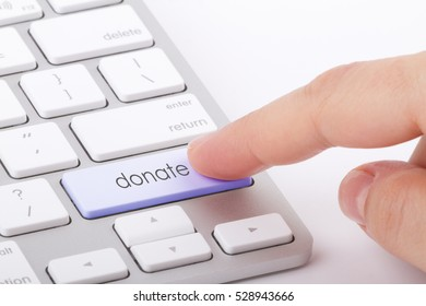 Donate word written on computer keyboard.