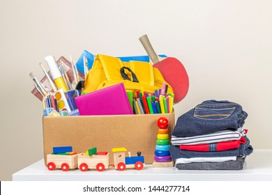 Donation box with clothes, books, school supplies and toys for charity