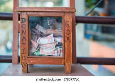Donation box in front of toilet in Nepal , money