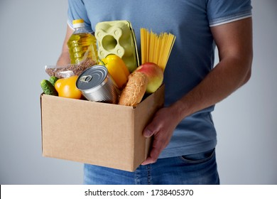 Donation cardboard box with various food. Grocery food delivery during pandemic, online shopping or donation concept.