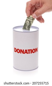 Donation collection box with hand donating money concept for charity  and relief work, help and support