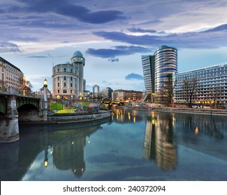 Donaukanal (Danube Canal) of Vienna, Austria. At the right the new UNIQA-Tower and opposite the historic building Urania, a public educational institute and observatory.