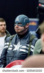 Doncaster Comic Con 11th Feruary 2018 at The Doncaster Dome. Man dressed as Captain America from Marvel comics Avengers in cosplay fancy dress at a comic con convention