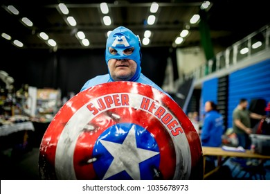 Doncaster Comic Con 11th Feruary 2018 at The Doncaster Dome. Man dressed as Marvel character Captain America for charity in cosplay fancy dress and a comic con convention