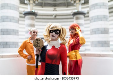 Doncaster Comic Con 11th Feruary 2018 at The Doncaster Dome. Three young women cosplay as Harley Quinn Suicide Squad and Marvels Jean Grey Phoenix