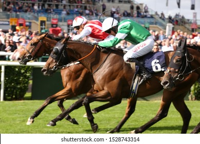 DONCASTER RACECOURSE, SOUTH YORKSHIRE, UK : 11 SEPTEMBER 2019 : Sammy Jo Bell riding Dubai Acclaim (far side) wins the Leger Legends Race in a photo finish from Hammer Gun and Noel Fehily (near side)