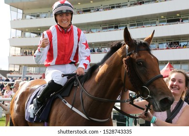 DONCASTER RACECOURSE, SOUTH YORKSHIRE, UK : 11 SEPTEMBER 2019 : Jockey Sammy Jo Bell returns to the Winners Enclosure on Dubai Acclaim after winning the 2019 running of the Leger Legends Stakes