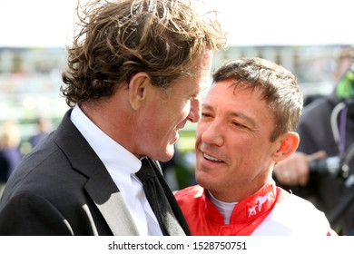 DONCASTER RACECOURSE, SOUTH YORKSHIRE, UK : 11 SEPTEMBER 2019 : Two Great Champions - Sir A P McCoy and Frankie Dettori meet and share a joke at Doncaster Races