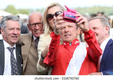 DONCASTER RACECOURSE, SOUTH YORKSHIRE, UK : 11 SEPTEMBER 2019 : Champion Jockey Frankie Dettori takes a selfie with Kevin Darley, George Duffield and Michael Hills in the picture at Doncaster Races