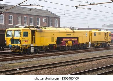DONCASTER, SOUTH YORKSHIRE, UK - MARCH 5, 2013: Network Rail's Plasser & Theurer 09-3X-D-RT Tamper/Liner/DTS No. DR73113 stands at Doncaster.