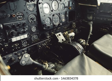 DONCASTER, UK - 28TH JULY 2019: Close up of a planes cockpit showing instruments and panels from an old abandoned two seater plane