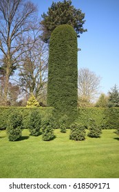 DONCASTER, UK - APRIL 8, 2017: Topiary in the garden of Brodsworth Hall, South Yorkshire. Brodsworth Hall is one of best surviving examples of a Victorian country house in England.