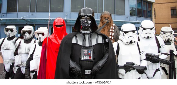DONCASTER, UK - OCTOBER 7, 2017.A group of serious cosplayers at a comic con event wearing costumes from Star Wars including Darth Vader, Stormtroopers and Chewbacca and lined up in formation.