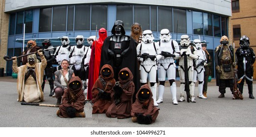 DONCASTER, UK - OCTOBER 7, 2018. A group of cosplayers dressed as characters from the Star Wars movies including Darth Vader, Stormtroopers, Chewbacca and Jawas at a comic con in Doncaster, UK.