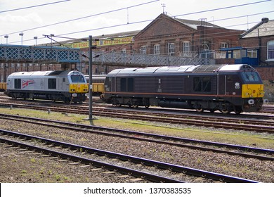 DONCASTER, YORKSHIRE, UK - APRIL 3, 2014: DB Schenker Class 67 No. 67005 'Queens Messenger' and DB Schenker 'Royal' Class 67 No. 67026 'Diamond Jubilee' stand at Doncaster.