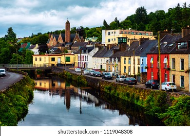 Donegal, Ireland. Beautiful landscape in Donegal, Ireland with river and colorful houses. Cloudy sky in summer, old bridge over the river